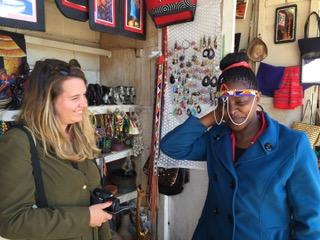 Volunteer Agatha shopping for souvenirs to bring back
