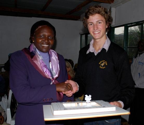 volunteer Christopher presenting school model