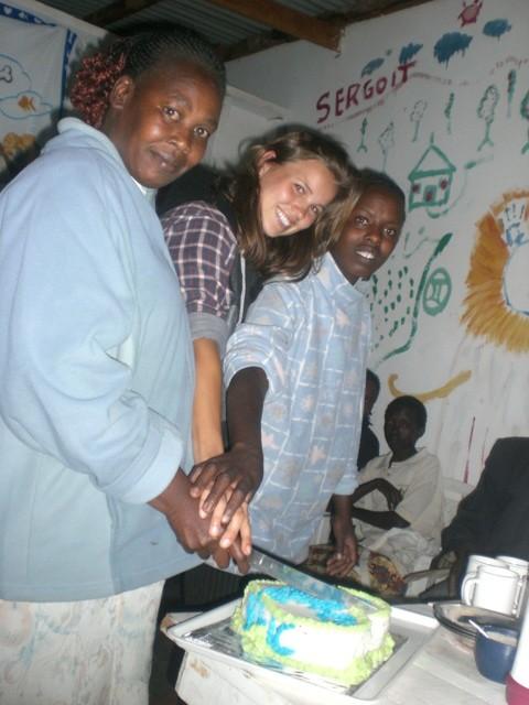 volunteer Laura celebrating opening of Youth Center