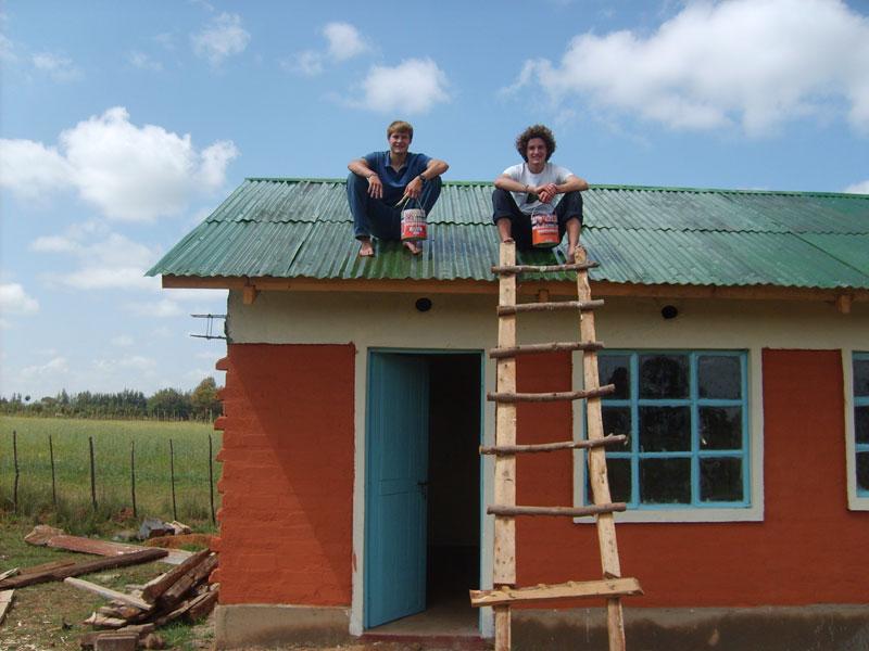 volunteer William Christopher on new school house roof